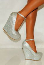 silver wedges love love i want these for the wedding Like, Comment, Repin !!
