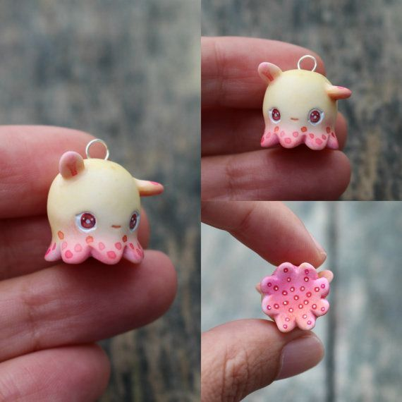 This is a tiny handsculpted and painted dumbo octopus :)  If you choose the faux suede option please send me a message once youve checked out with the colour youd like, or I shall choose a matching one!  You will recieve the exact one in the picture glazed and carefully packaged!  This little one is only about 1.5cm ❤❤❤  Follow me on Instagram for news, updates & follower goodies: http://instagram.com/thelittlemew  Dont forget to have a WONDERFUL day