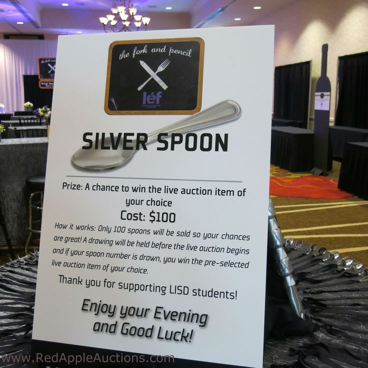 Raffle using silver spoons on a ribbon
