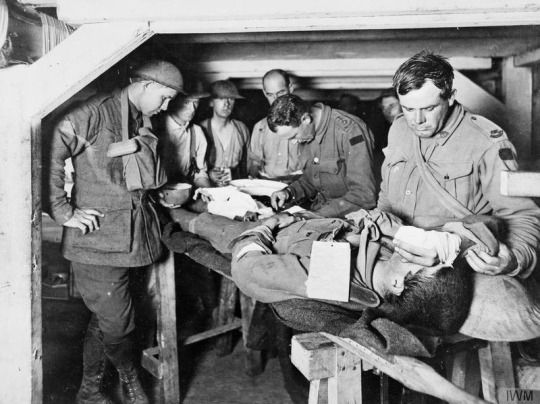 An Australian Medical Officer attends a wounded man at an Advanced Dressing Station during the Third Battle of Ypres (Passchendaele).