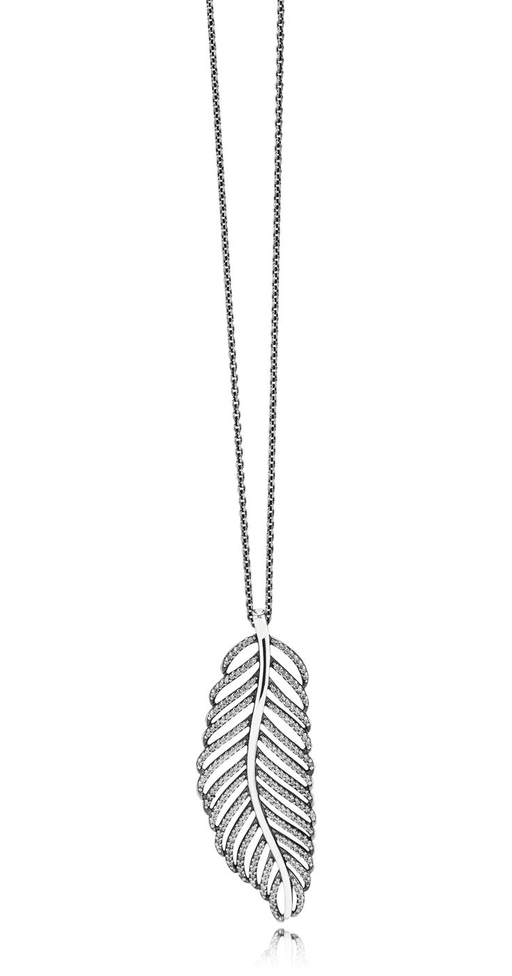 This statement feather pendant is extremely stunning. Wear it on a sterling silver chain to complete your look. Made from sterling silver, it features a cutout feather design that has been adorned with hand-set clear cubic zirconia, adding sparkle and elegance. #PANDORA #PANDORAnecklace