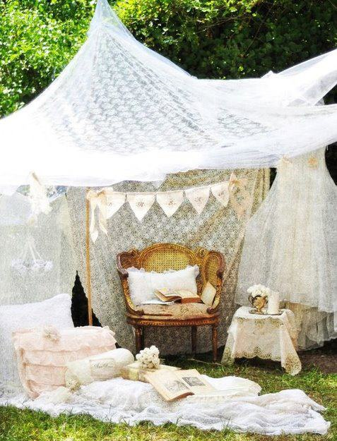 Shabby Chic garden party in the sun with pretty vintage lace panels, curtains and bedspreads - who could refuse?
