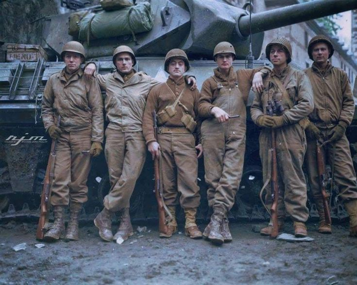 Men of the 823rd Tank Destroyer Battalion, Co. C in front of an M-10. They were credited with disabling four Mk VI Tigers of the SS 501st Heavy Tank Battalion near Stavelot, Belgium on December 19, 1944.