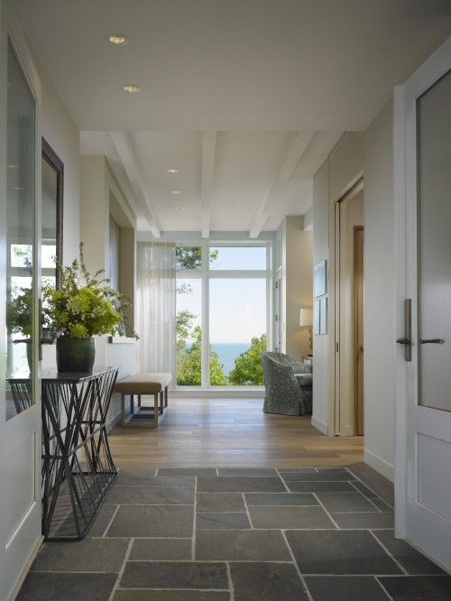 Entry that has a great view as soon as you walk in the door. Robbins Architecture Also love stone floors leading to timber floors