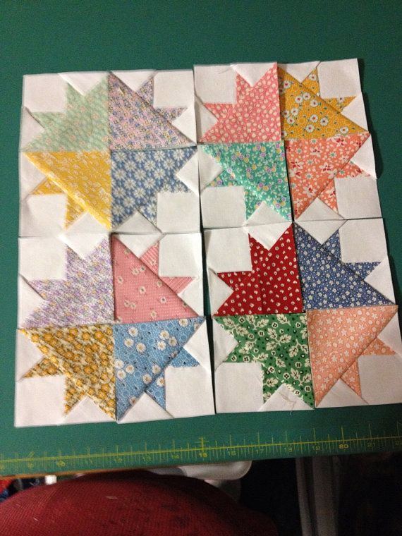 You will be getting 16 miniature quilt blocks ( 3 finished size, 3 1/2 unfinished)!in assorted 1930s reproduction fabrics. The white is Kona