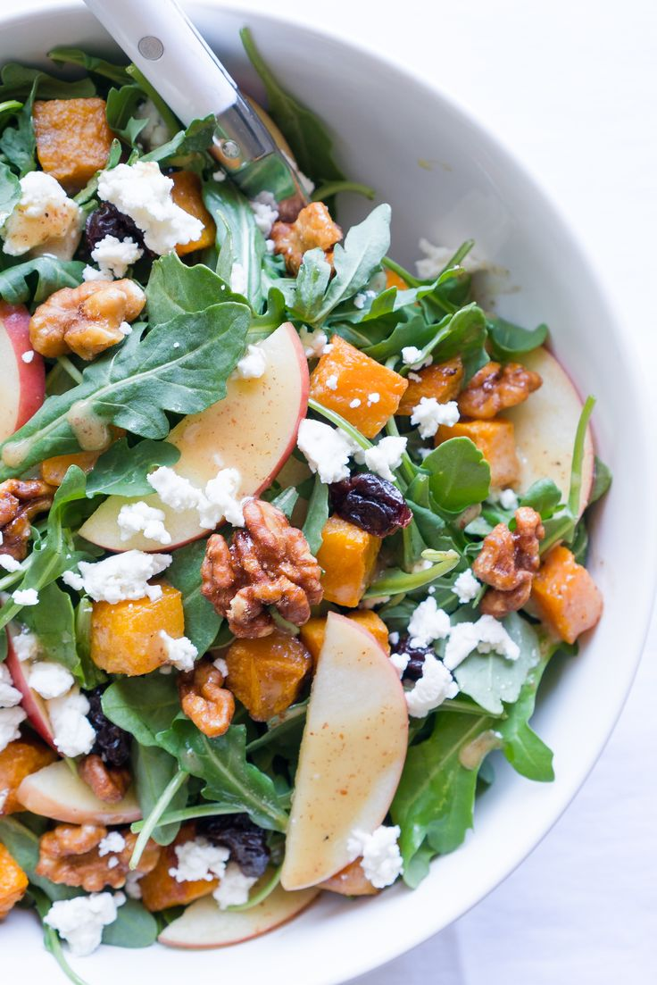 Healthy recipe for Roasted Butternut Squash Salad! Paired with fresh apple, dried tart cherries, goat cheese, candied walnuts, & a maple vinaigrette!