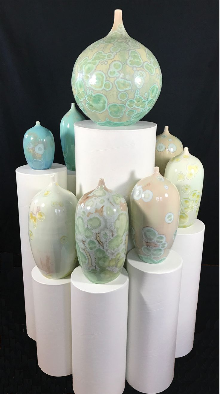 Bjarne Nielsen. Different shades of green using 1/2 to 1% CuO. Different  types of porselain.