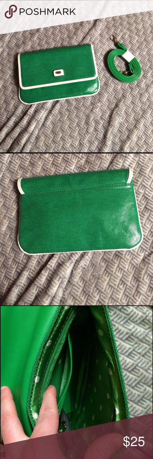 Grace Adele clutch Cute green and white Grace Adele clutch. Like new condition. Only used for about a month as a wallet. Has a strap that can be attached but I never used it. Comes with a dust bag. Grace Adele Bags Clutches & Wristlets