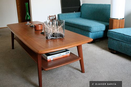 I want that coffee table AND those love seats. I saw some similar ones at Broadway Antique Market and they were gorgeous!