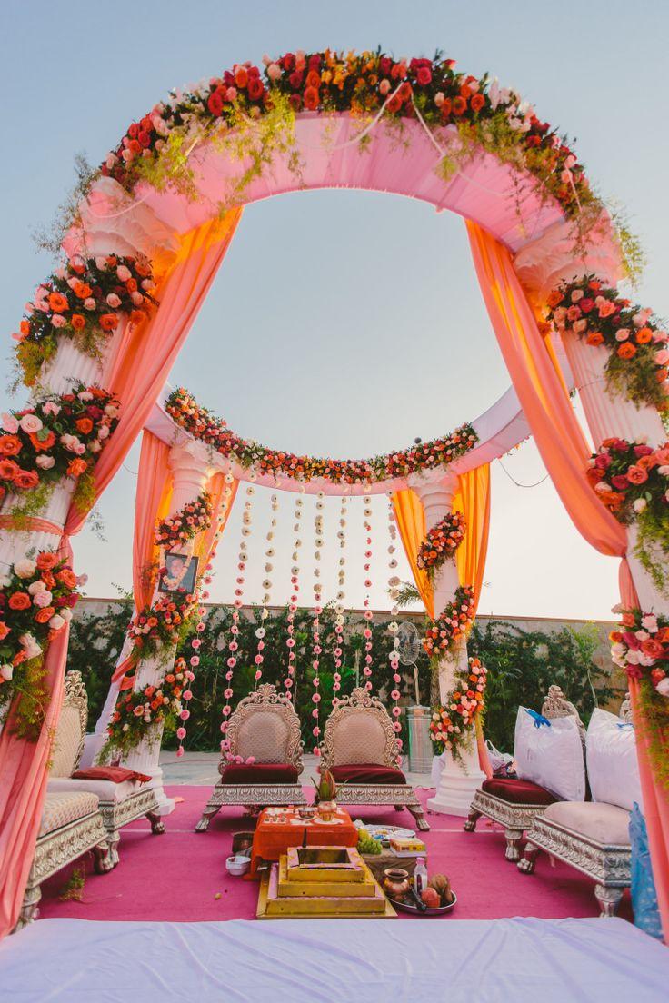 An outdoor mandap setup - orange and pink !