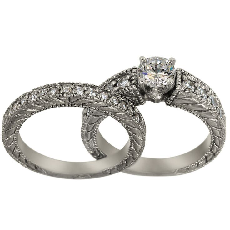 Heavy Two Ring Diamond Engagement Setting With Engraved Shanks -  This antique ring set has a combined total weight of 0.90ct of round accent diamonds and the engagement ring can accommodate any size and shape center diamond.    This is a delicate interpretation of the Victorian style in 14K white gold. Both the engagement ring and the wedding band have a matching decoration comprised of delicate diagonal lines engraved on either side and brilliant diamond accents covering the half top…
