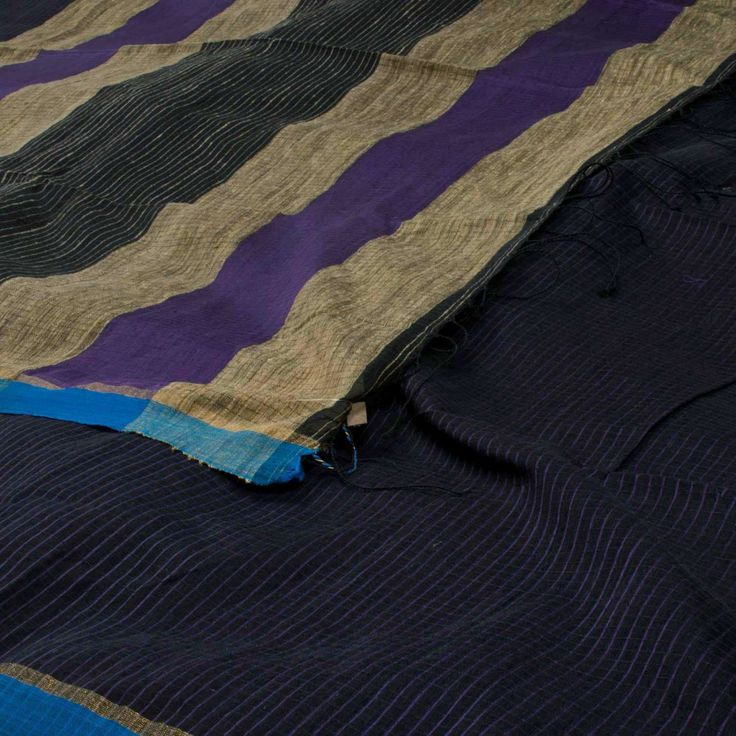 "The ""#Black"" #handwoven #Khadi #Silk #Cotton #Sari from Ssaha is woven with purple striped body that is set off by a blue border on either side. An attractive beige and purple adorn the pallu."