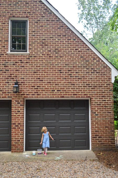 garage door color ideas for orangebrick house - Urbane Bronze by Sherwin Williams in their Duration line