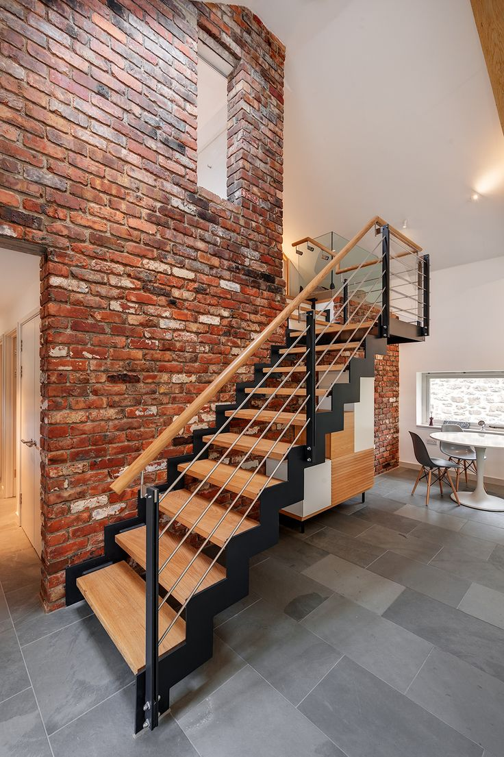 barn renovation and extension with handmade steel and oak staircase and red