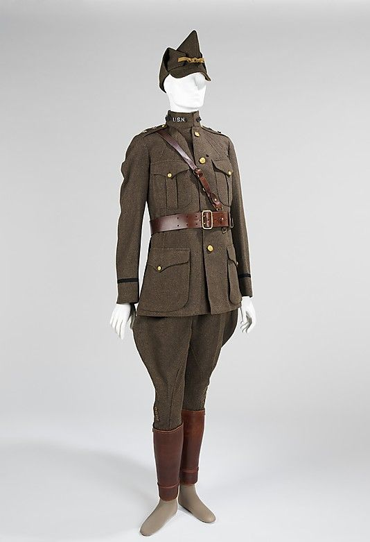 American uniform from World War I. Made of wool and leather, it also features a Sam Browne belt, which is noted for its cross-body strap. The uniform also includes a foldover cap called an 'overseas cap.'