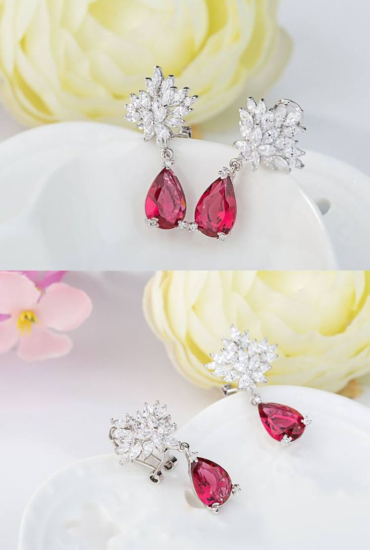 *Free shipping worldwide* Featuring the pear-cut synthetic ruby dangles, these dainty earrings look gorgeous both worn alone or coordinated with other accessories. | bridal earrings | wedding earrings | bridesmaid earrings | prom earrings | occasion earrings | rose gold earrings | bridal jewelry | wedding jewelry | prom jewelry | occasion jewelry | bridal jewellery | wedding jewellery | prom jewellery | red earrings | red jewelry