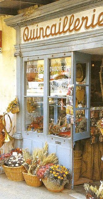 Love the baskets of flowers!  Flower shop Great Blog Site - Décor de Provence