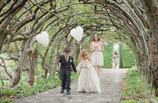 There are no little girls in our families, but we have plenty of adorable little boys! I love this idea of carrying ballons down the aisle, something appropriate for the boys!