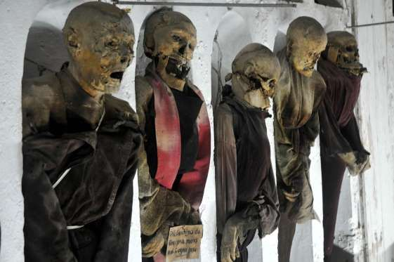 CATACOMBE DEI CAPPUCCINI - ITALY In the Catacombe dei Cappuccini (Capuchin Catacombs) in Sicily, Italy, the preserved bodies of both Capuchin monks and local townspeople stand on display. The mummification tradition began in the 16th century and lasted for hundreds of years.
