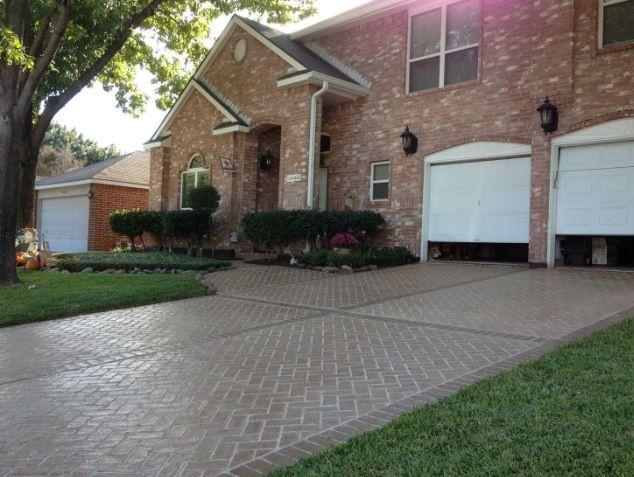 Herringbone Brick Stamped Concrete driveway!!! Absolutely beautiful!!!! Talk about curb appeal!!! www.bossresurfacing.com