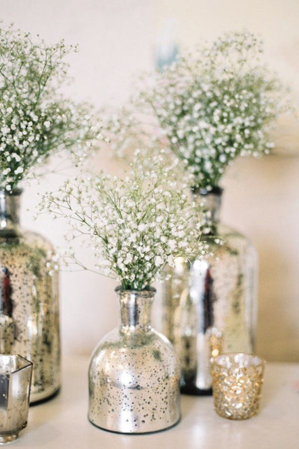 MERCURY GLASS Fill mercury vases with baby's breath (yes, it's back in style) or other white flowers to add height and texture to tables.