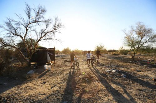 Cody, Damien & Erik heading to the empty pool on a dope desert day in Slab City California