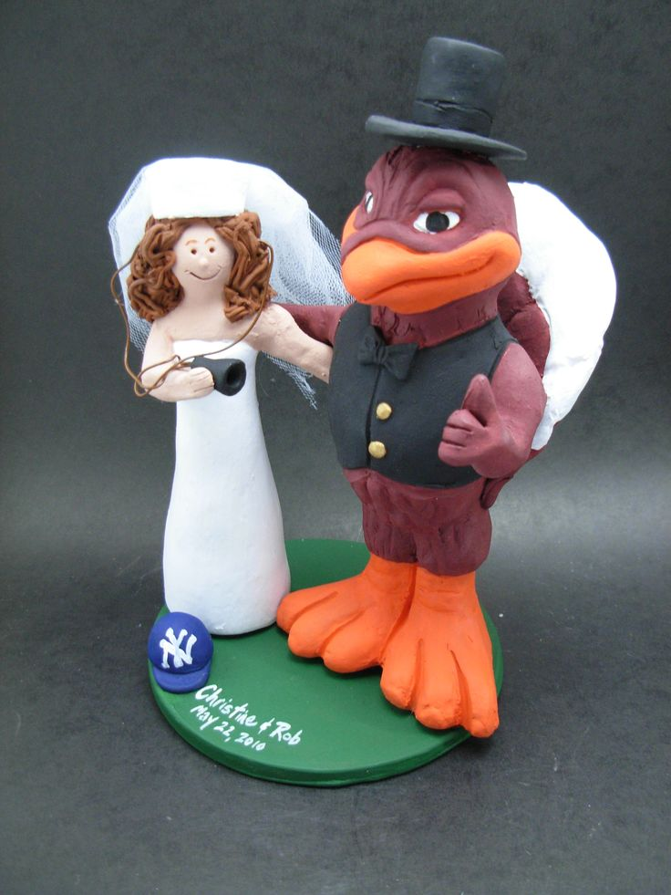 Custom made to order Hokie bird and bride college mascot wedding cake toppers. $235 www.magicmud.com 1 800 231 9814 magicmud@magicmud... blog.magicmud.com twitter.com/... $235 #mascot #collegemascot #hokie #ms.wuf #gators #virginiatech #football mascot #wedding #toppers #custom #Groom #bride #weddingcaketoppers #caketoppers www.facebook.com/... www.tumblr.com/... instagram.com/... magicmud.com/Wedding photos.htm