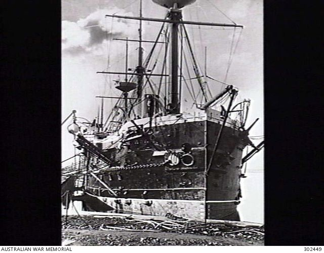 PORTSMOUTH, ENGLAND. C.1891. DETAIL VIEW OF THE BOW OF THE ARMOURED CRUISER HMS NELSON AS SHE APPEARED AFTER HER 1889-1891 REFIT. HER SAILING RIG HAS BEEN REDUCED AND FIGHTING TOPS CONTAINING 3 ...