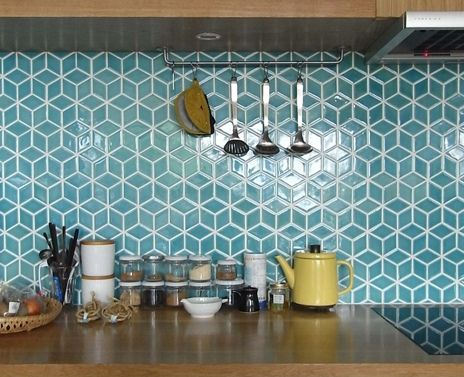 Geometric tiles, in a white and maple kitchen.