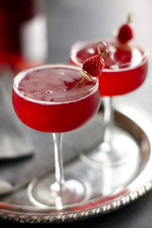 Raspberry Ginger Bellini Cocktails served in beautiful coupe glasses for a vintage inspired speakeasy look.