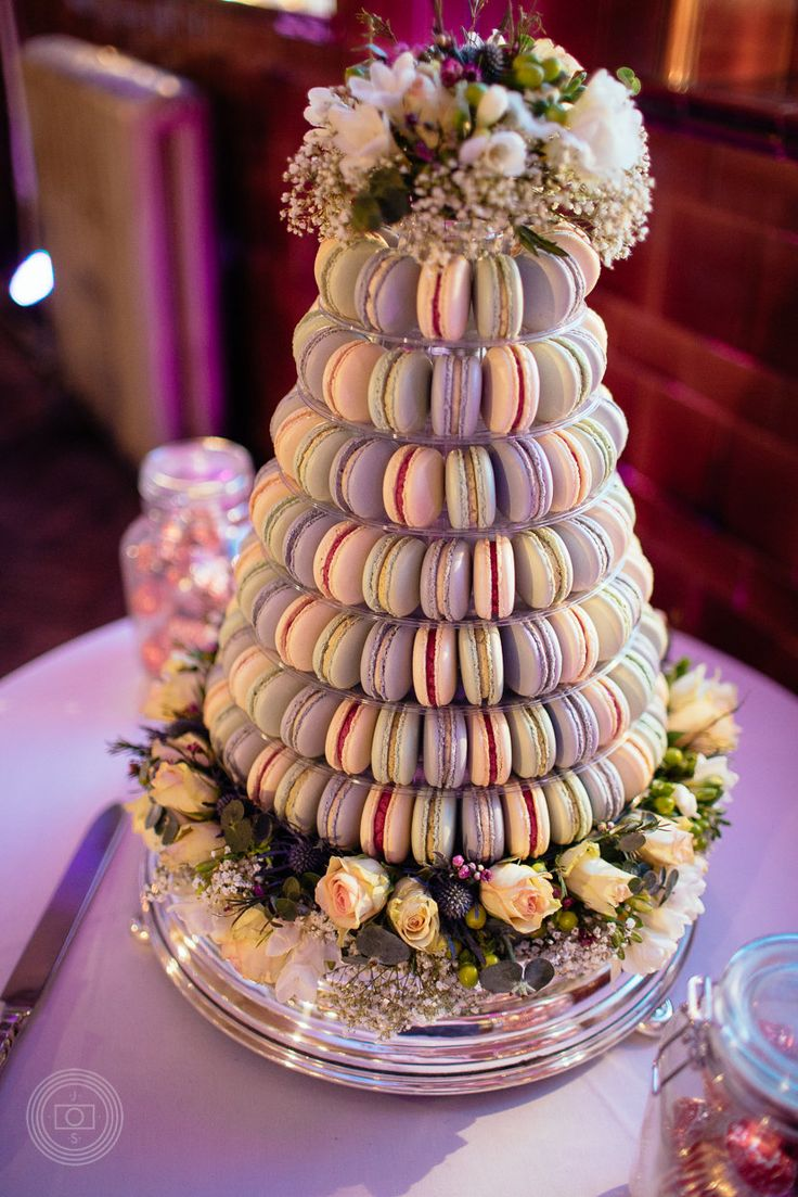 Macaron wedding tower dressed with flowers. Vanilla, pistachio and blackcurrant macarons. Photo by Joe Stenson Photography Macaron wedding cake, alternative wedding cake, macaroon wedding cake