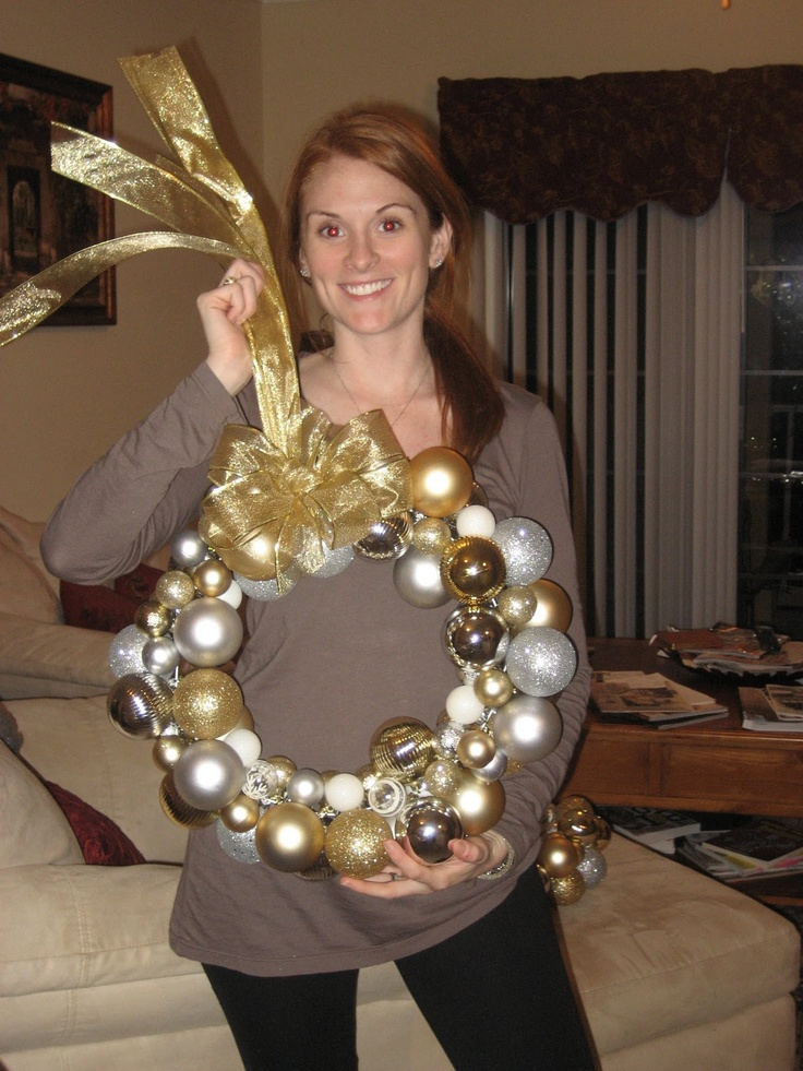 Comfy Cozy Couture: DIY Christmas Ornament Wreath - tried 12/2/12 - BEAUTIFUL!  made a big one with a full wire hanger, then cut a bunch in half to make small ones for the doors inside the house :)  Need to buy more ornaments though......these really do take a LOT!