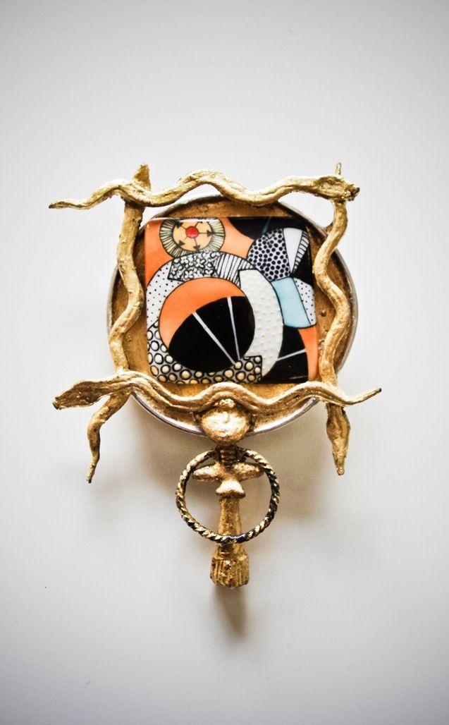 "Mervi Kurvinen, ""Cult Parameter"" brooch, in silver, bronze, iron and gold leaf. Hand painted porcelain by Tarja Häsa, 2014. #Finland #artjewelry"