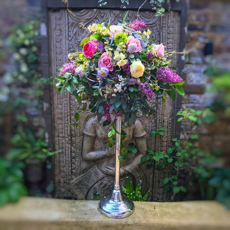 Bright florals for a wedding table candelabra design