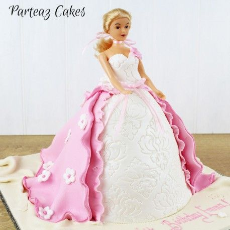 The dress forms the edible part of this popular little girls princess themed birthday cake. Pink princess cake with white bodice and a pink polka dot gown, complete with sugar bow.