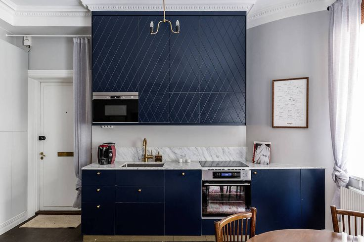 Navy kitchen with marble countertop