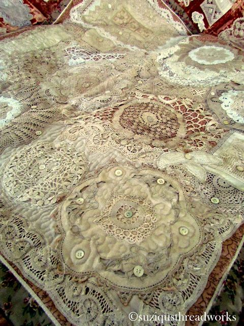 Quilt made out of doilies and velvet...beautiful.