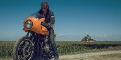 Starting line from the Mont-Saint-Michel to do the Tour de France with a CafeRacer Motorcycle