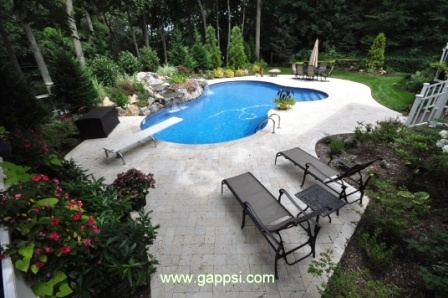 Pool Patio Made Of White Travertine Paving Stones In Stony