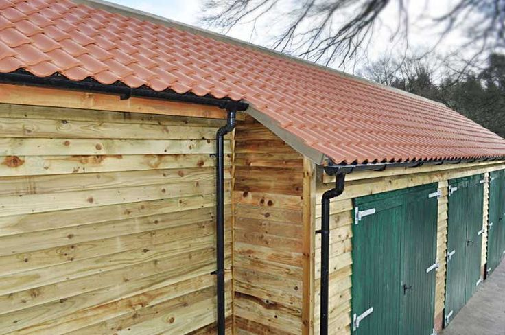 New Sandtoft 20/20 pantiled roof with tanalised timber fascias, soffits and cladding with new plastic guttering - Brandsby.
