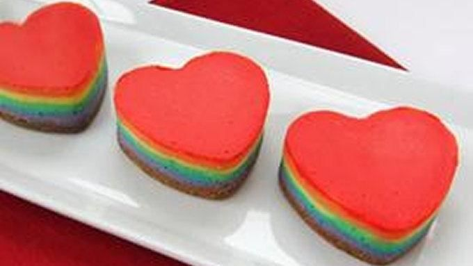 Heart shaped cheesecakes layered with the colors of the rainbow make sweet Valentines Day treats. These individual servings of dessert would also be perfect for a wedding shower or a birthday party.