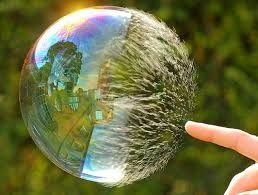 shutter speed captures the texture of a bubble as it is being poped