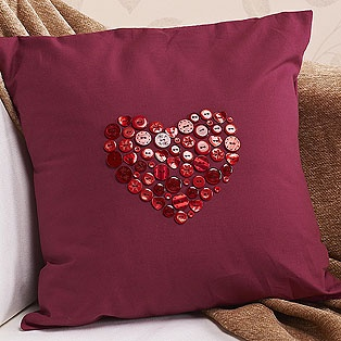 I can soo cheat-make this! Buy a plain cushion case of my choice and sew in an array of buttons in any colour and style of my choice. Simple.