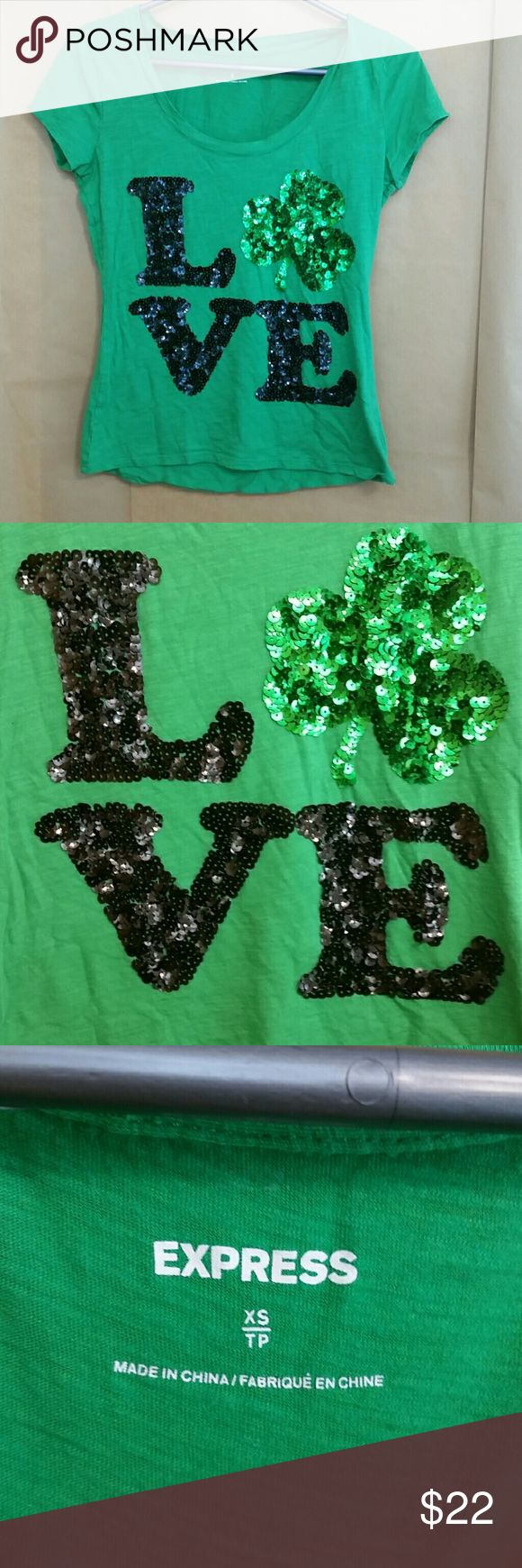 Express green Saint Patrick's Day sequin tee sz XS Kiss me, I'm Irish! Cute kelly green short sleeve tee with black and green sequin LOVE design from Express. Soft cotton blend. Excellent used condition with no pulls or missing sequins! Size XS. Happy Saint Patrick's Day! Express Tops Tees - Short Sleeve