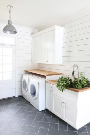 laundry room - stack washer/dryer cabinets above and butcher block counter
