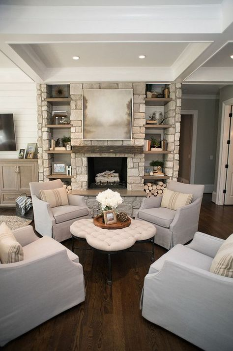 Living room Chairs. Four chairs together creates an inviting sitting area by the fireplace. Living room chairs are Chairs are Azriel swivel glider from Sam Moore furniture. #Livingroom #Chairs #Livingroomchairs Artisan Design Studio