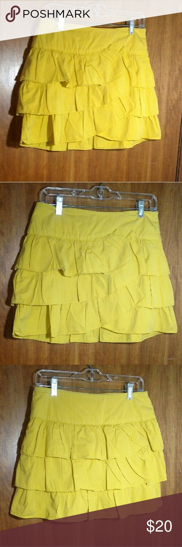 Zara Mustard Yellow Cotton Ruffle Skirt Cotton ruffle skirt has tiered layers which are set a little bit diagonally in the front to create an overlap area to one side. Lined. Side zip with hook and eye closure to. Size medium by Zara Basics. In nice pre-owned condition, no stains, tears, or other visible flaws. Zara Skirts