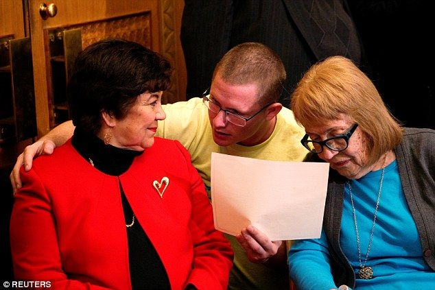 Electoral College electors (L-R) Sen. Polly Baca, Michael Baca (no relation) and Ann Knollman talk before taking the oath of office in the Governor's office at the State Capitol in Denver. Michael Baca is being prosecuting for violating his oath and casting his vote for Ohio Governor John Kasich