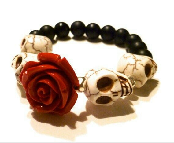 Bracelet with rose.  I would need to replace the skeletons with something prettier