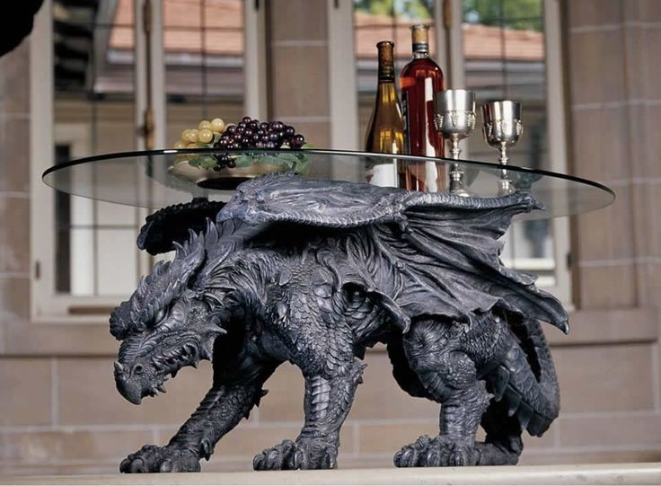 Warwickshire Dragon Glass-Topped Coffee Table Is Ideal For Any Targaryen's Lair  From the award-winning fantasy art and replica sculptors of Design Toscano, we present the only grand accoutrement worthy of succeeding their exceptio...